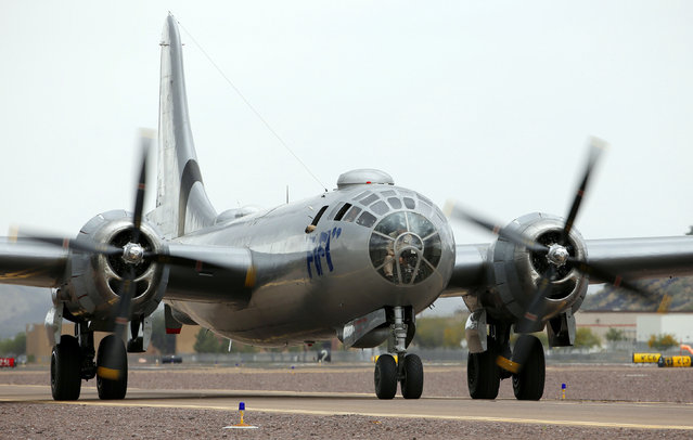 """The Commemorative Air Force's World War II era B-29 Superfortress bomber plane """"FIFI"""" taxis to an area near the terminal, Monday, February 23, 2015, at Deer Valley Airport in Phoenix. (Photo by Ross D. Franklin/AP Photo)"""