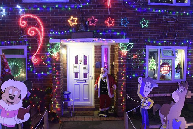 A home is decorated with a display of  Christmas of lights in a tradition that has grown over recent years in the small village of Westfield in Sussex, south east England, December 15, 2016. (Photo by Toby Melville/Reuters)