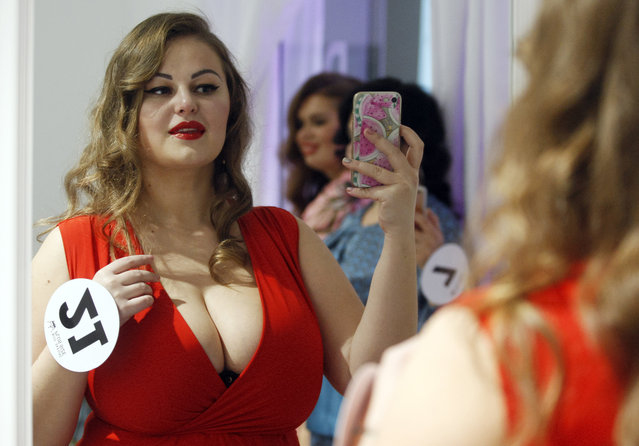 "A contestant photographs a selfie photo backstage during the ""Miss Ukraine Plus Size"" beauty pageant in Kiev, Ukraine on October 29, 2018. (Photo by Pavlo Gonchar/SOPA Images via ZUMA Wire)"
