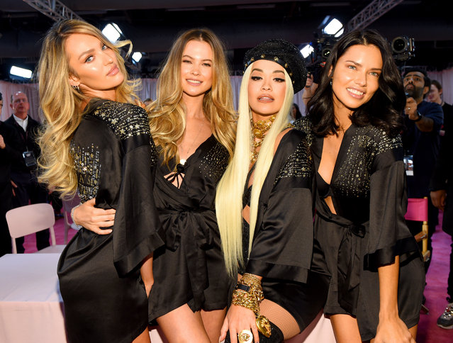 (L-R) Candice Swanepoel, Behati Prinsloo, Rita Ora and Adriana Lima prepare backstage during 2018 Victoria's Secret Fashion Show in New York at Pier 94 on November 8, 2018 in New York City. (Photo by Dimitrios Kambouris/Getty Images for Victoria's Secret)