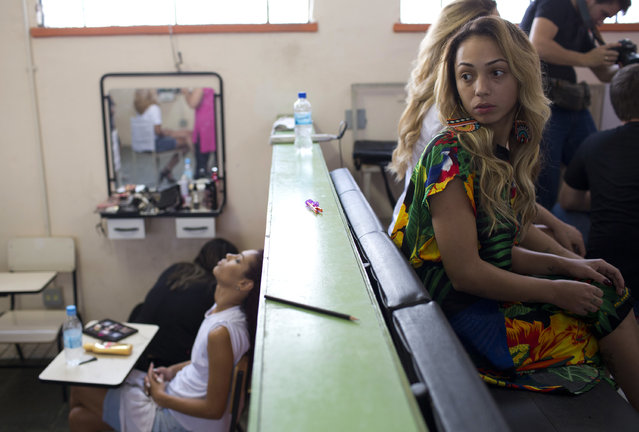 Inmates wait to have their hair styled and make up done to compete in the 13th annual Miss Talavera Bruce beauty pageant at the penitentiary the pageant is named for, in Rio de Janeiro, Brazil, Tuesday, December 4, 2018. Hairdressers and makeup artists volunteer their time to ready the contestants who are judged on their beauty, appeal and attitude. (Photo by Silvia Izquierdo/AP Photo)