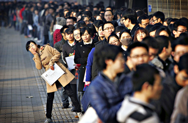 Job seekers line up at a job fair at Tianjin University November 22, 2013. According to local media, more than 6,000 people rushed to the job fair on Friday for openings from 300 companies against the backdrop that a decrease is expected in available positions for fresh graduates in the China job market in 2014. (Photo by Reuters/Stringer)