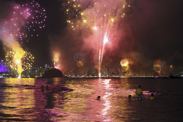 Fireworks explode over the Acapulco bay during a New Year's Eve celebration in Acapulco, Mexico, Sunday, January 1, 2017. At least five people were killed over the New Year's weekend in the Mexican resort city of Acapulco, including three men found decapitated in a central neighborhood. (Photo by Bernandino Hernandez/AP Photo)