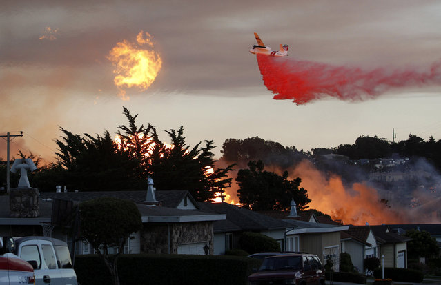In this September 9, 2010, file photo, a massive fire following a pipeline explosion roars through a mostly residential neighborhood in San Bruno, Calif. Repeated natural-gas accidents including a pipeline explosion that killed eight people suggest that Pacific Gas & Electric Co., California's largest power utility, may be too big to operate safely, the state's top utility regulator says. (Photo by Jeff Chiu/AP Photo)