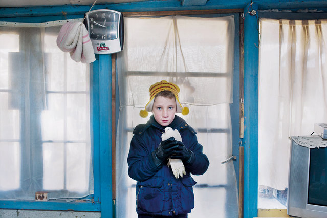 """""""Honorable Mention"""". This picture is a part of the series of my work 'Frumoasa'. """"Frumoasa"""" is Romanian for 'beauty'. It's a work about Laurentiu and his family. They live in shacks next to the railway near the Ghent Dampoort. I met him and his family in December 2012. They have to deal with all kind of obstacles on a daily basis. Photo location: Ghent Dampoort Belgium. (Photo and caption by Aurélie Geurts/National Geographic Photo Contest)"""