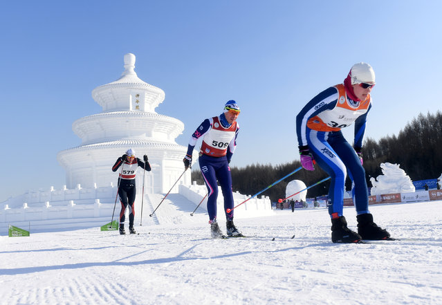 Contestants ski past a snow replica of the Qinian Hall of the Temple of Heaven during a competition in Changchun, Jilin province, January 4, 2017. (Photo by Reuters/Stringer)