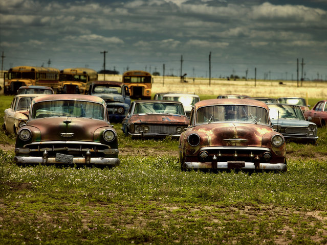 Old-fashioned motors are abandoned with school buses, in 2014, Texas. (Photo by Dieter Klein/Barcroft Media)