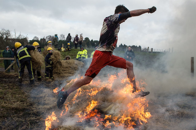 A competitor makes their way through fire as they take part in the Tough Guy endurance event near Wolverhampton, central England, on January 27, 2019. (Photo by Oli Scarff/AFP Photo)