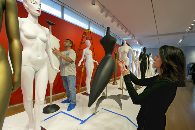 Curator Barbara Paris Gifford directs the installation of The Art of the Mannequin, by artist Ralph Pucci, at the Museum of Arts and Design, in New York on Thursday, March 26, 2015. (Photo by Richard Drew/AP Photo)