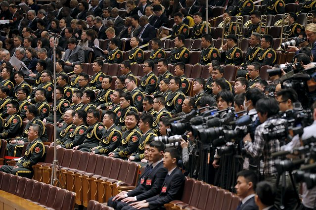 Military band members sit inside the Great Hall of the People during the opening session of the National People's Congress (NPC) in Beijing, China, March 5, 2016. (Photo by Damir Sagolj/Reuters)