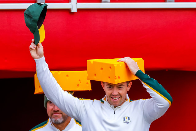 European team members Rory McIlroy (R) of Northern Ireland and Lee Westwood (L) of England wear foam cheese hats while walking to the first tee during a practice round for the pandemic-delayed 2020 Ryder Cup golf tournament at the Whistling Straits golf course in Kohler, Wisconsin, USA, 22 September 2021. Competition for the 43rd Ryder Cup between the US and Europe begins 24 September 2021. (Photo by Erik S. Lesser/EPA/EFE)