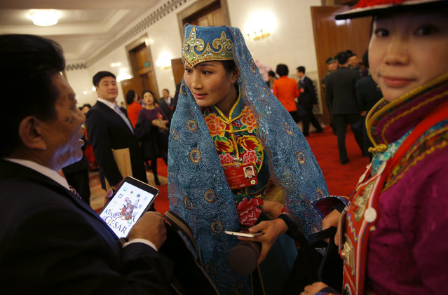 Ethnic minority delegates talk ahead of the second plenary session of the National People's Congress (NPC) at the Great Hall of the People in Beijing, China, March 9, 2016. (Photo by Damir Sagolj/Reuters)