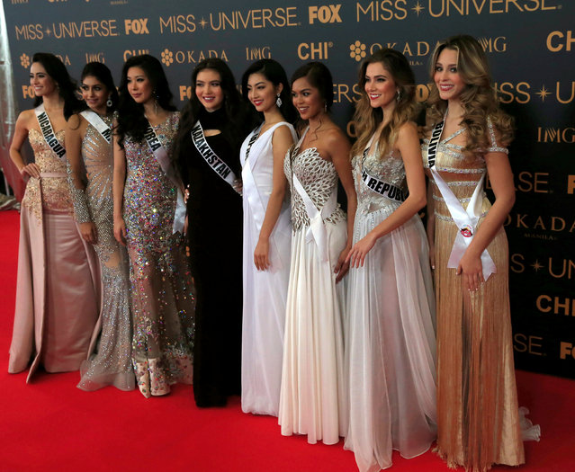 Miss Universe candidates pose for a picture during a red carpet inside a SMX convention in metro Manila, Philippines January 29, 2017. In Photo from L-R: Miss Nicaragua Marina Jacoby, Miss Malaysia Kiran Jassal, Miss Korea Jenny Kim, Miss Kazakhstan Darina Kulsitova, Miss Japan Sari Nakazawa, Miss Guam Muneka Taisipic, Miss Czech Republic Andrea Bezdekova and Miss Boliva Antonella Moscatelli. (Photo by Romeo Ranoco/Reuters)
