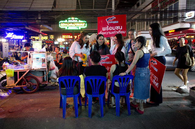 In this Wednesday, February 13, 2019 photo, Pauline Ngarmpring, left, speaks with workers of a roadside massage parlor during an election campaign in Bangkok, Thailand. As Pinit Ngarmpring, he was a CEO and sports promoter, well known in the world of Thai soccer. Now, under her preferred new name of Pauline Ngarmpring, she's pursuing a bid to become the country's first transgender prime minister. (Photo by Gemunu Amarasinghe/AP Photo)