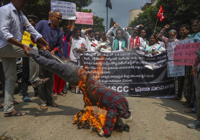 Indian farmers protesting against Sunday's killing of four farmers in Uttar Pradesh state after being run over by a car owned by India's junior Home Minister Ajay Mishra burn an effigy of the federal government in Hyderabad, India, Monday, October 4, 2021. Indian authorities on Monday suspended Internet services and barred political leaders from entering a northern town to calm tensions after eight people were killed in a deadly escalation of a year-long demonstration against contentious agriculture laws. (Photo by Mahesh Kumar A./AP Photo)