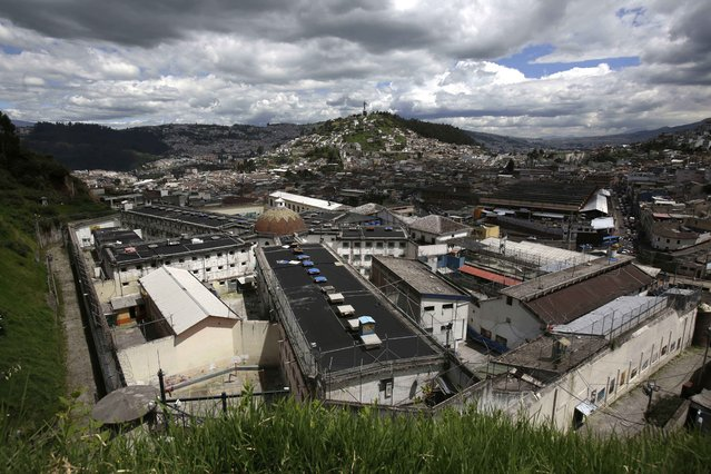 This April 9, 2015 photo shows the Garcia Moreno Prison, located in the middle of the capital city of Quito, Ecuador. The four-block-long building with numerous wings has been abandoned since September, when the 2,600 prisoners living in a space originally built for just 300 people were transferred to a larger and more modern penitentiary. (Photo by Dolores Ochoa/AP Photo)