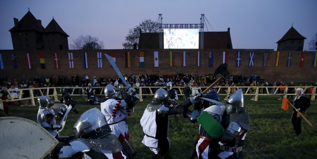 "Fighters compete in the ""10 vs 10"" competition at the Medieval Combat World Championship at Malbork Castle, northern Poland, April 30, 2015. (Photo by Kacper Pempel/Reuters)"
