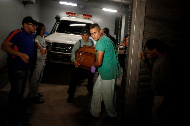 Forensic carrying a coffin with one of the victims in the crash between a bus and a truck at the morgue in Tegucigalpa, Honduras February 5, 2017. (Photo by Jorge Cabrera/Reuters)