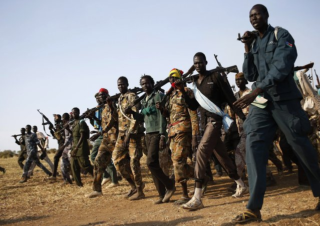 Jikany Nuer White Army fighters, a local youth militia affiliated with the rebels, walk in Upper Nile State February 12, 2014. South Sudanese rebels withdrew on Tuesday a threat to boycott peace talks with the government, saying mediators had promised to address their list of demands. (Photo by Goran Tomasevic/Reuters)