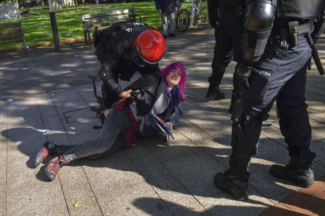 A female basque pro independence demonstrator is detained by riot policeman as Santiago Abascal, leader of Spanish far right party Vox, holds a  meeting during a General Election campaign, in Bilbao, northern Spain, Saturday, April 13, 2019. Spain's political parties are set to launch two-week campaigns leading up to an April 28 election. (Photo by Alvaro Barrientos/AP Photo)