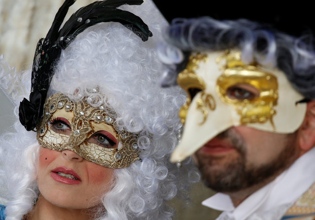 Masked revellers pose during the Venice Carnival in Venice, Italy February 12, 2017. (Photo by Tony Gentile/Reuters)