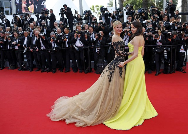 """Actress and model Hofit Golan (L) poses on the red carpet as she arrives for the opening ceremony and the screening of the film """"La tete haute"""" out of competition during the 68th Cannes Film Festival in Cannes, southern France, May 13, 2015. (Photo by Yves Herman/Reuters)"""