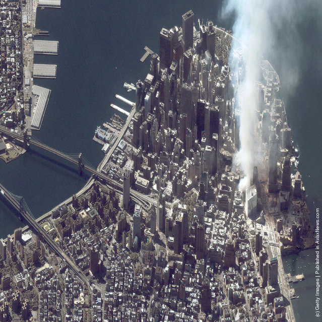A satellite image of lower Manhattan shows smoke and ash rising from the site of the World Trade Center at 11:43 a.m. September 12, 2001 in New York City