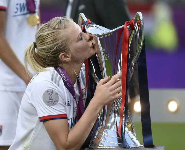 Ada Hegerberg of Olympique Lyon kisses the trophy after the women's soccer UEFA Champions League final match between Olympique Lyon and FC Barcelona at the Groupama Arena in Budapest, Hungary, Saturday, May 18, 2019. Lyon defeated Barcelona by 4-1. (Photo by Balazs Czagany/MTI via AP Photo)