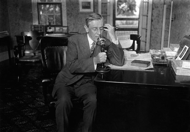 President Woodrow Wilson speaks on telephone. Woodrow Wilson was the 28th U.S. President serving from 1913 – 1921. (Photo by Corbis)