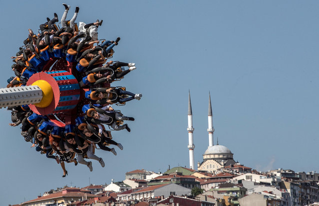 People enjoy a fun fair during the Eid al-Fitr festival in Istanbul, Turkey, 04 June 2019. Muslims around the world are celebrating Eid al-Fitr, the three day festival marking the end of the Muslim holy fasting month of Ramadan. Eid al-Fitr is one of the two major holidays in Islam. (Photo by Sedat Suna/EPA/EFE)