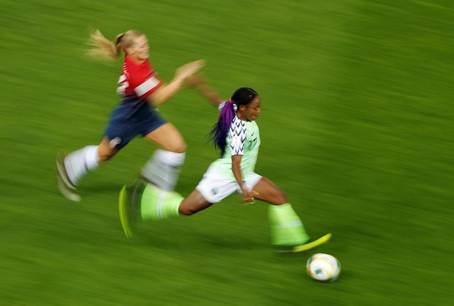 Norway's forward Lisa Utland (L) vies with Nigeria's forward Francisca Ordega during the 2019 Women's World Cup Group A football match between Norway and Nigeria, on June 8, 2019, at the Auguste-Delaune Stadium in Reims, eastern France. (Photo by Gonzalo Fuentes/Reuters)