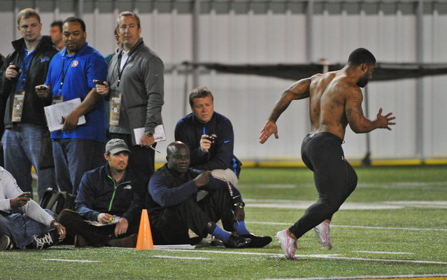 Scouts time Georgia Tech NCAA college football running back Robert Godhigh, right,  during his 40 yard sprint on NFL pro day Friday, March 28, 2014, in Atlanta. (Photo by David Tulis/AP Photo)