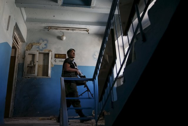 """A member of the Ukrainian armed forces patrols in the town of Maryinka, eastern Ukraine, June 5, 2015. Ukraine's president told his military on Thursday to prepare for a possible """"full-scale invasion"""" by Russia all along their joint border, a day after the worst fighting with Russian-backed separatists in months.  REUTERS/Gleb Garanich"""