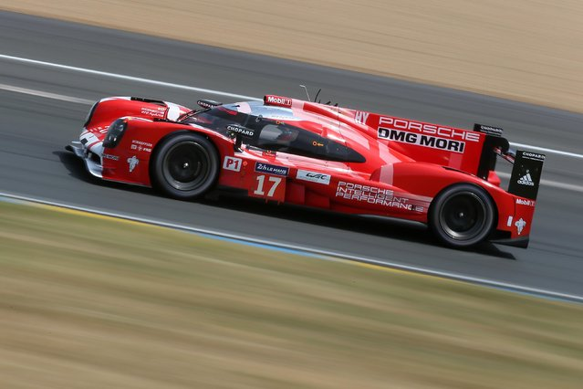 The Porsche 919 Hybrid No17 of the Porsche Team driven by Timo Bernhard of Germany is seen in action during the 83rd 24-hour Le Mans endurance race, in Le Mans, western France, Saturday, June 13, 2015. (AP Photo/David Vincent)