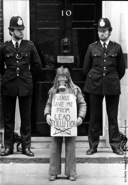 1978: 9 year old Rachel Geary stands outside No 10 Downing St wearing a gas mask and holding a banner