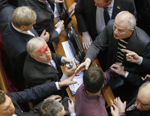 Deputies react after clashes during debates on the country's budget for 2014 in the Parliament in Kiev January 16, 2014. (Photo by Gleb Garanich/Reuters)