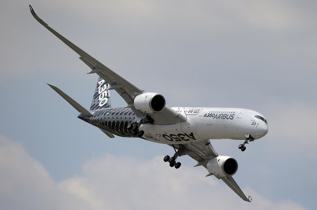 An Airbus A350 performs a demonstration flight at the Paris Air Show, in Le Bourget airport, north of Paris, Wednesday, June 17, 2015. Some 300,000 aviation professionals and spectators are expected at this week's Paris Air Show, coming from around the world to make business deals and see dramatic displays of aeronautic prowess and the latest air and space technology. (AP Photo/Francois Mori)