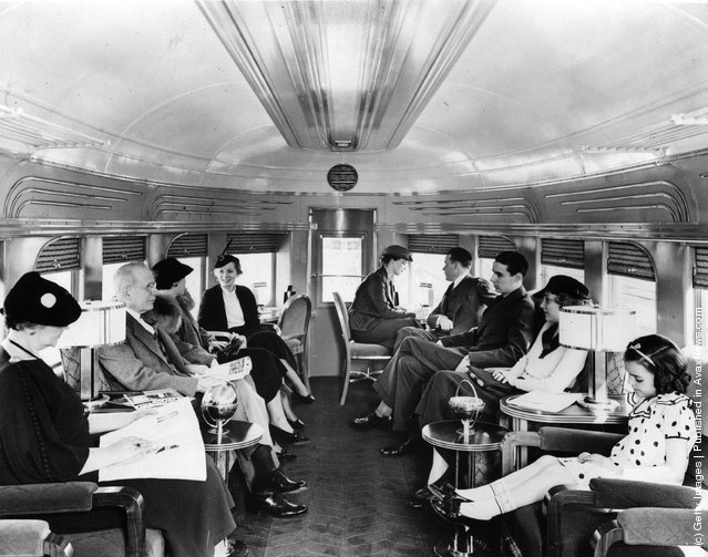 Passengers in the spacious lounge car on the new streamlined diesel train 'Green Diamond', introduced by the Illinois Central System to run fast services between Chicago and Illinois