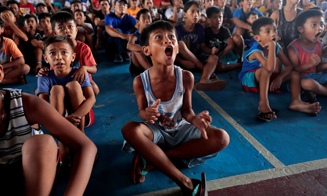 Filipino boxing fans celebrate after Manny Pacquiao wins the WBA Welterweight fight against Keith Thurman of the U.S. during a live public viewing of the match in Marikina, Philippines, July 21, 2019. (Photo by Eloisa Lopez/Reuters)