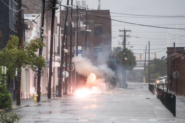 Power lines spark in flood water on Market Street as Hurricane Dorian spins just off shore on September 5, 2019 in Charleston, South Carolina. Hurricane Dorian is now at Category 2 strength as it makes its way up the U.S. East Coast, unleashing flooding, high winds and tornadoes, according to published reports. (Photo by Sean Rayford/Getty Images)