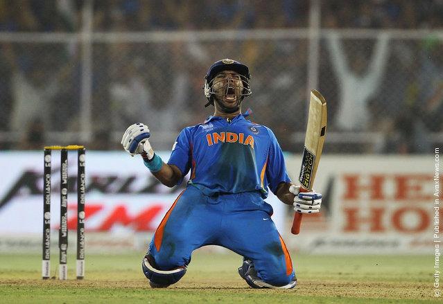Yuvraj Singh of India celebrates hitting the winning runs during the 2011 ICC World Cup Quarter Final match between Australia and India at Sardar Patel Stadium