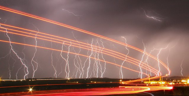 Mass lightning bolts light up night skies by the Daggett airport from monsoon storms passing over the high deserts early Wednesday, north of Barstow, California July 1, 2015. Picture taken using long exposure. (Photo by Gene Blevins/Reuters)