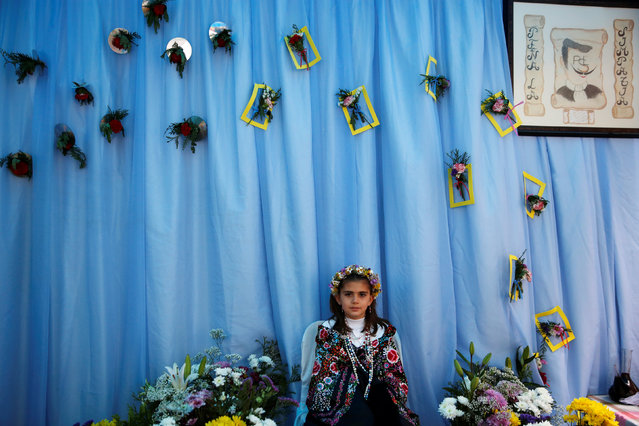 """""""Maya"""" girl Sara Prieto Aparicio, 9, sits at an altar during """"Las Mayas"""" festivity in Madrid, Spain, May 8, 2016. (Photo by Susana Vera/Reuters)"""