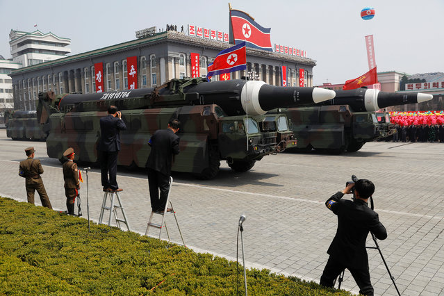 Missiles are driven past the stand with North Korean leader Kim Jong Un and other high ranking officials during a military parade marking the 105th birth anniversary of country's founding father Kim Il Sung, in Pyongyang April 15, 2017. (Photo by Damir Sagolj/Reuters)