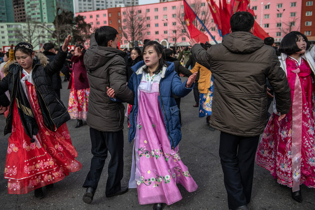 """North Koreans, including women in traditional Korean hanbok dresses, take part in a mass dance to mark the 71st anniversary of the Korean Peoples Army on February 08, 2019 in Pyongyang, North Korea. U.S President Donald Trump and North Korean Supreme Leader Kim Jong Un will hold a second summit in the Vietnamese capital of Hanoi later this month following a historic summit in Singapore last June. Although the two countries remain technically at war and with negotiations surrounding the details of North Korea's nuclear disarmament continuing, President Trump has hailed Kim Jong Un and North Korea with a tweet in which he predicted that the country would become """"a great economic powerhouse"""" thanks to Mr Kim's leadership. (Photo by Carl Court/Getty Images)"""