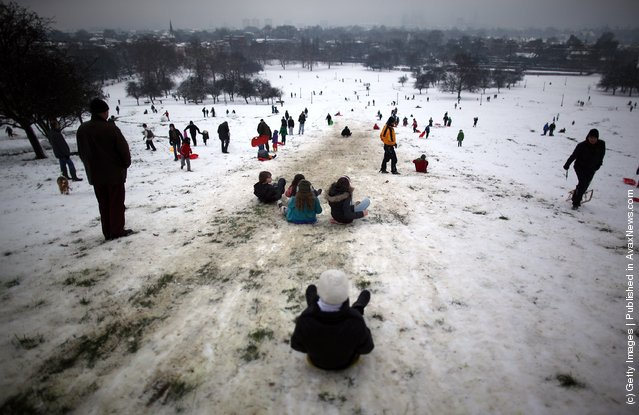 People enjoy the snow in Primrose Hill