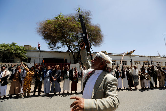 Tribesmen loyal to the Houthi movement raise up their rifles during a gathering to show support to the movement in Sanaa, Yemen, May 19, 2016. (Photo by Khaled Abdullah/Reuters)