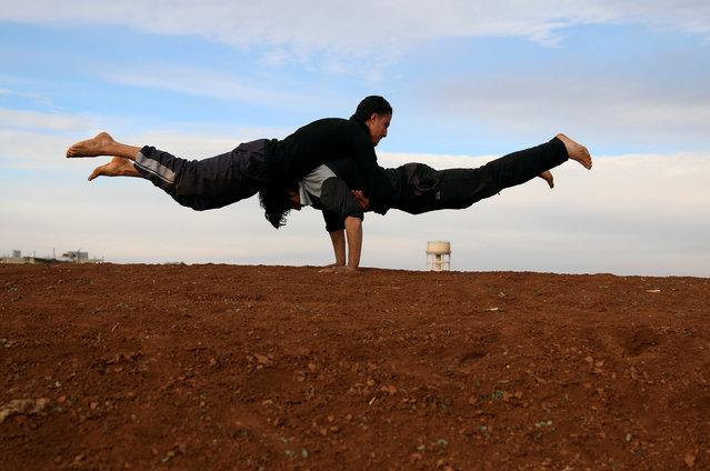 "Parkour coach Ibrahim al-Kadiri, 19, and Muhannad al-Kadiri (top), 18, demonstrate their parkour skills in the rebel-held city of Inkhil, west of Deraa, Syria, February 4, 2017. ""I love competing with my friends to achieve the highest jump"", Muhannad says. (Photo by Alaa Al-Faqir/Reuters)"