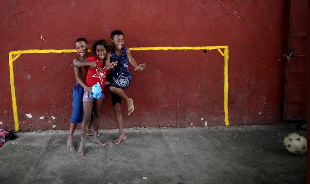 Children pose for pictures at Salgueiro slum in Rio de Janeiro, Brazil, Thursday September 30, 2010. (Photo by Natacha Pisarenko/AP Photo)