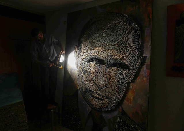 """A portrait of Russian President Vladimir Putin named """"The Face of War"""" which is made out of 5,000 cartridges brought from the frontline in eastern Ukraine, is seen in the studio of Ukrainian artist Dariya Marchenko, in Kiev, July 23, 2015. (Photo by Gleb Garanich/Reuters)"""